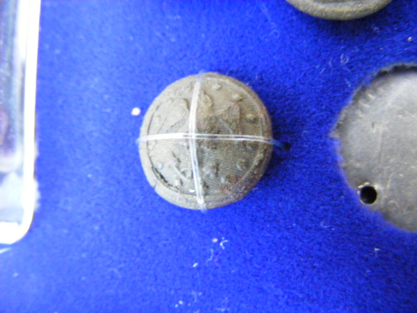 A Navy button.