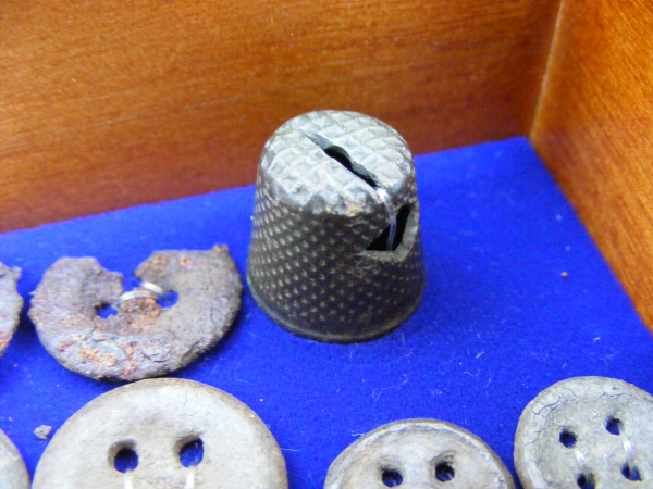 A modified/customized sewing thimble.