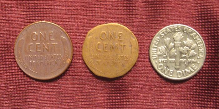 A full sized penny, the 'shaved' penny and a  dime